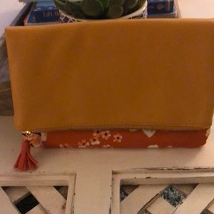 Floral and tan fold over zippered clutch
